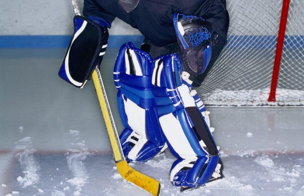 A hockey goalkeeper holding a goalie stick