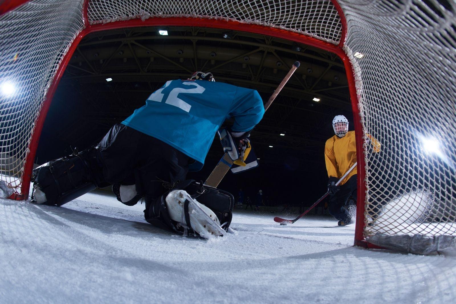 teach kids shoot hockey puck