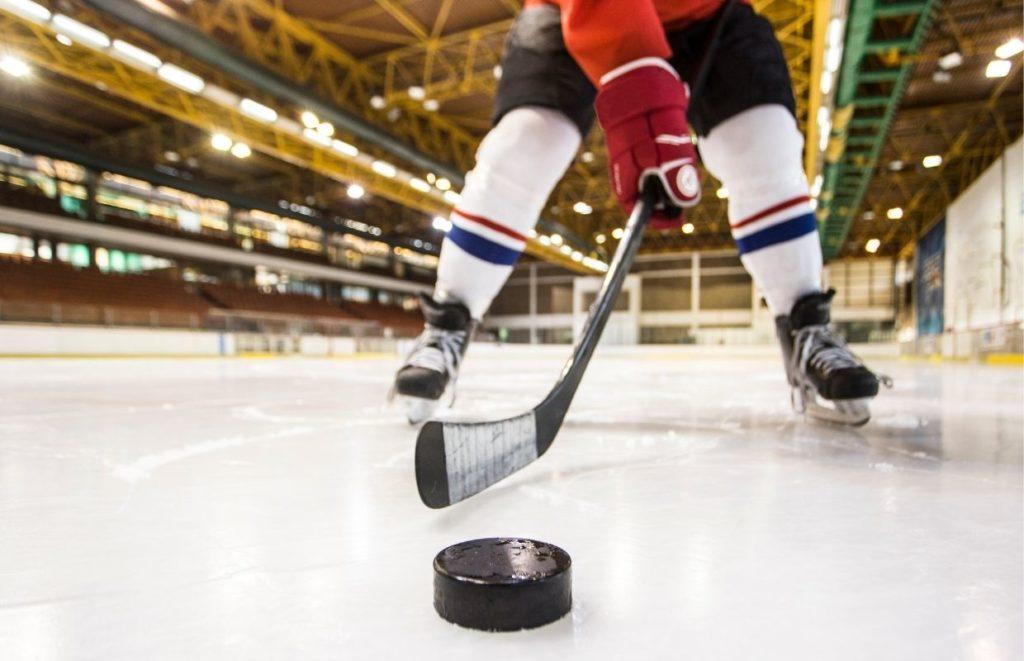 An ice hockey player wearing the best socks for hockey skates